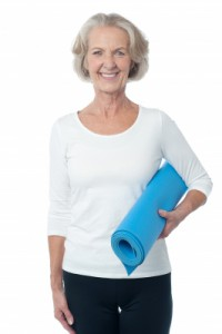 Seniors and Exercise: Senior Woman with Yoga Mat